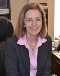 Judy Keller at her office desk